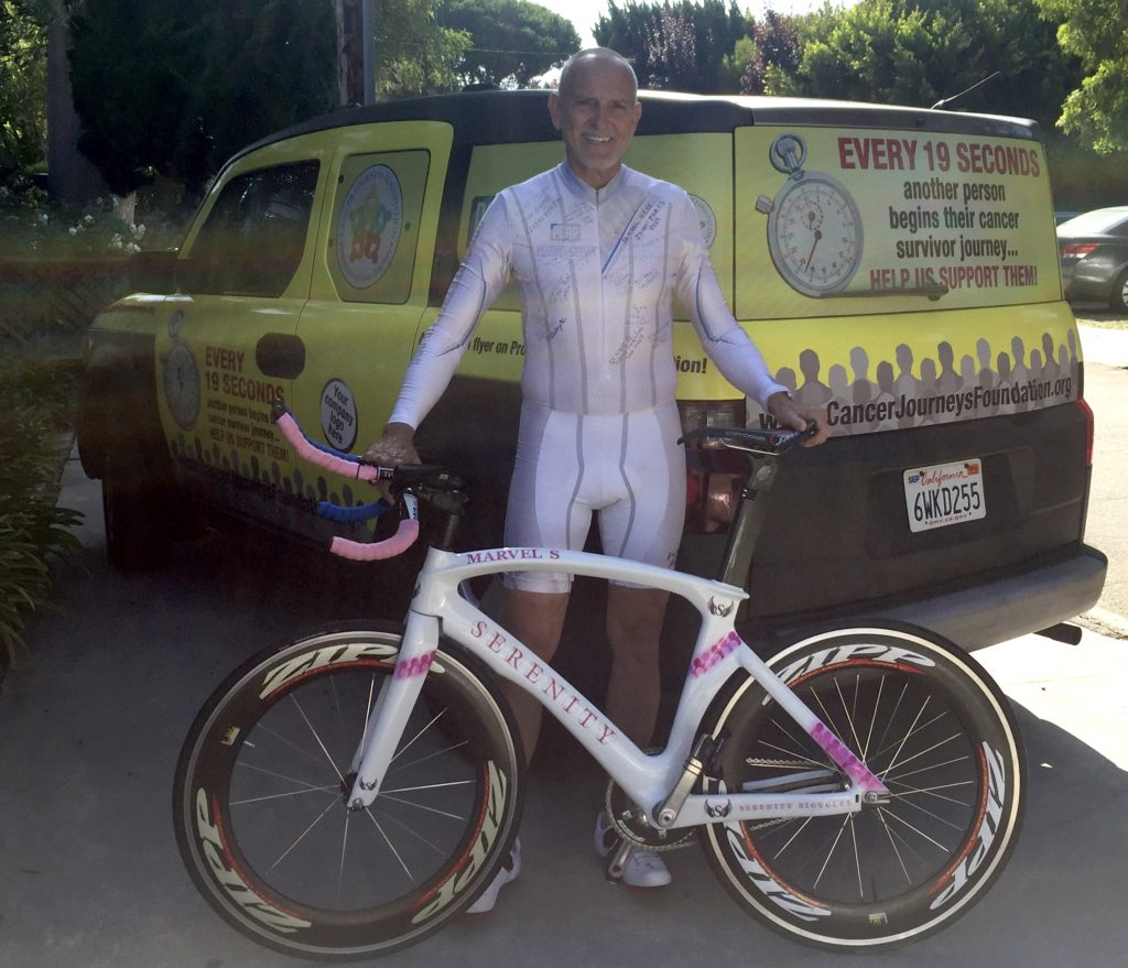 Picture of Cancer Journeys Foundation president Robert Warren Hess with Serenity Bicycle